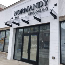 Front of Normandy Remodeling Transparent Suspended Flat Canopy
