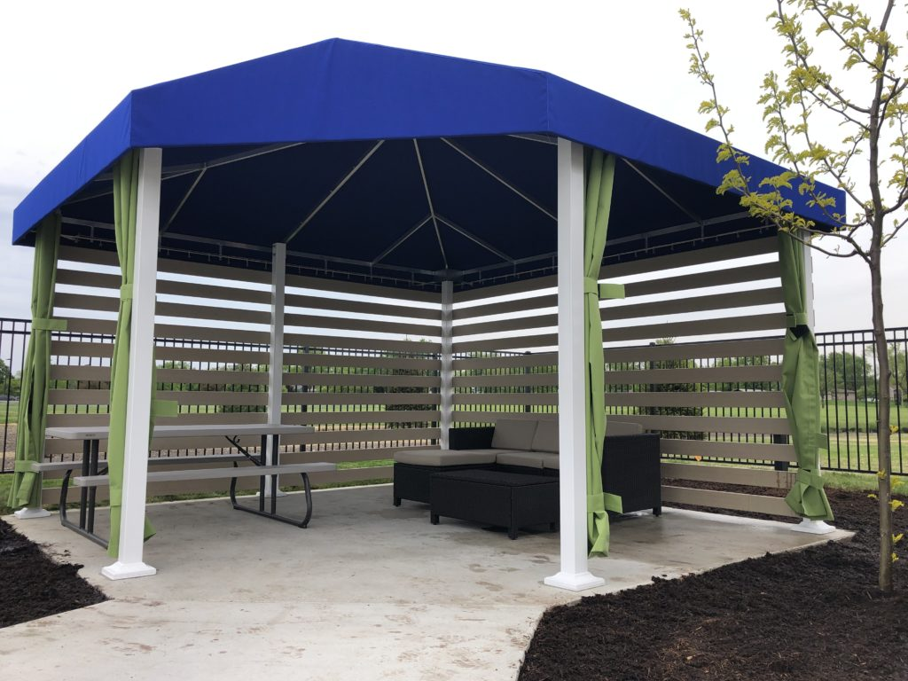Canvas shade structure with privacy courtain.